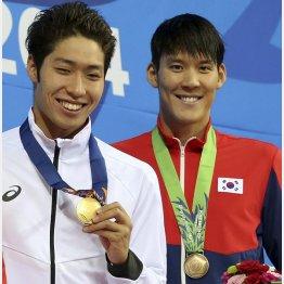 朴泰桓(右)は仁川アジア大会で萩野公介と表彰台に/(C)AP