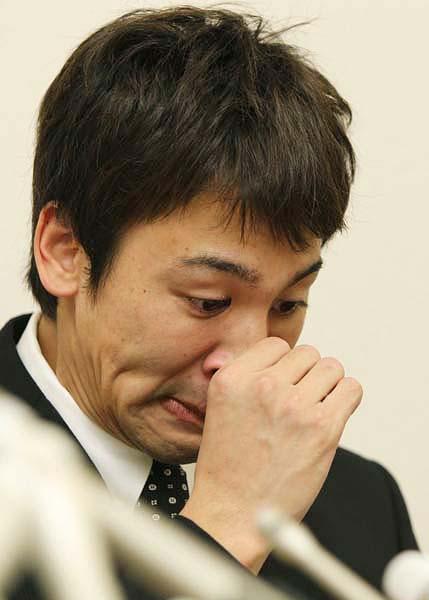 冨田は記者会見で控訴断念を明らかに(C)日刊ゲンダイ