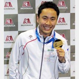 金メダルを手に笑顔を見せる太田(C)日刊ゲンダイ