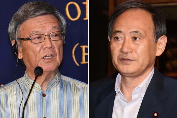 翁長・沖縄県知事(左)と菅官房長官(C)日刊ゲンダイ