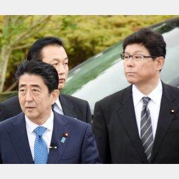 安倍首相と高木復興相(C)日刊ゲンダイ