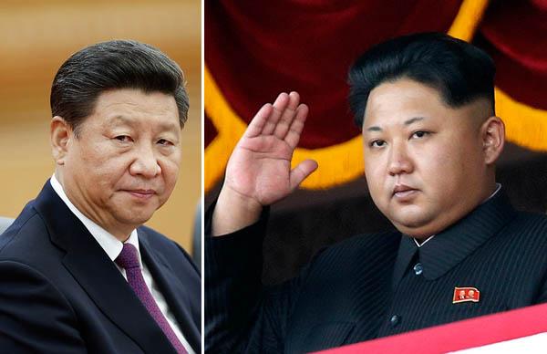 習近平国家主席(左)と金正恩(C)日刊ゲンダイ