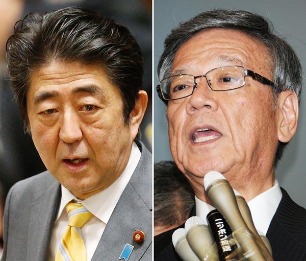 安倍首相と翁長沖縄県知事/(C)日刊ゲンダイ