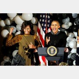反トランプが担ぎ出す(オバマ米大統領とミシェル夫人)/(C)ロイター