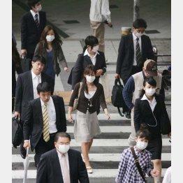 マスク姿が街中に(C)日刊ゲンダイ