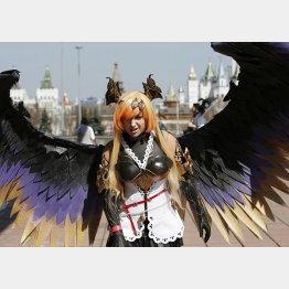 モスクワで開催された日本ポップ文化フェスティバルでコスプレを披露する女の子(C)ロイター