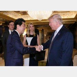 大統領就任前にトランプ氏に会いに行った安倍首相(C)ロイター