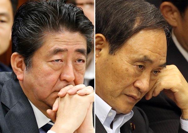 安倍首相(左)と菅官房長官/(C)日刊ゲンダイ