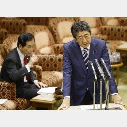 山本大臣(左)は部下をスパイ扱い(C)日刊ゲンダイ