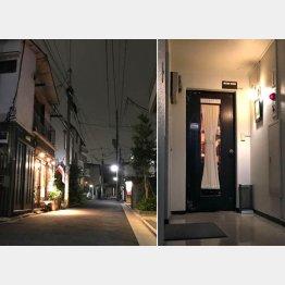 闇夜にタイ国旗がたなびく(右はベネンシアのドア)(C)日刊ゲンダイ