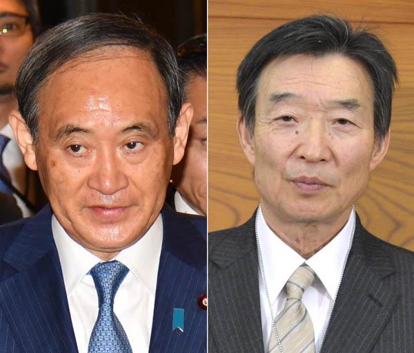 菅官房長官(左)と日銀の岩田副総裁(C)共同通信社