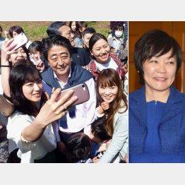花見客と写真撮影する安倍首相、右は昭恵夫人(C)共同通信社