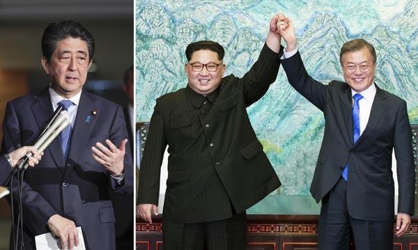 南北が握手する一方で…(C)韓国共同写真記者団・共同