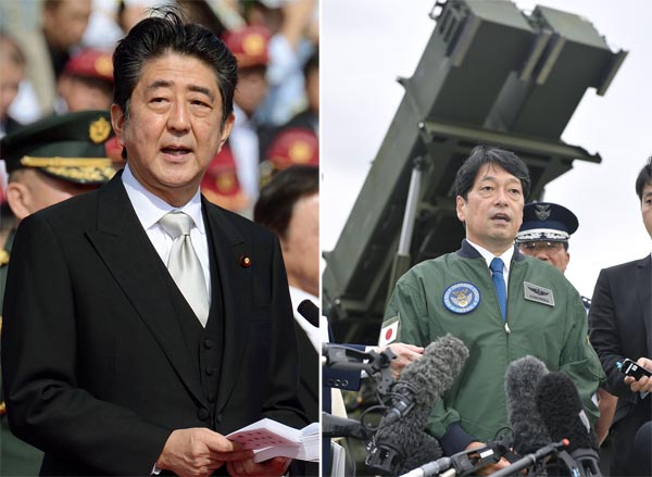 安倍首相と小野寺防衛相(C)共同通信社