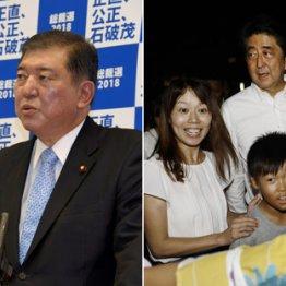 石破茂氏(左)と安倍首相