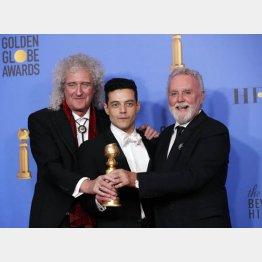 ゴールデン・グローブ賞受賞(左からブライアン・メイ、主演のラミ・マレック、ロジャー・テイラー)/(C)ロイター