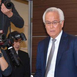 辞任を発表する田中前社長