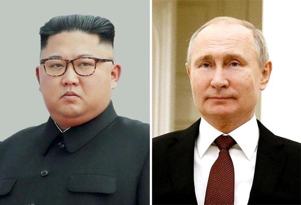 金正恩とプーチン大統領(C)共同通信社