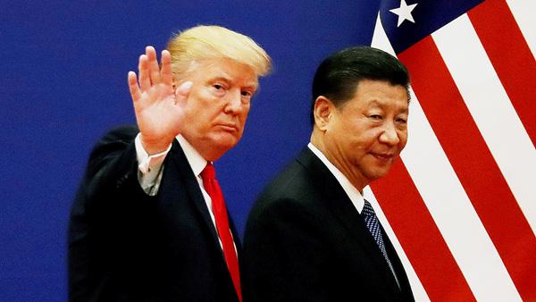 睨み合いは続く(トランプ米大統領と中国の習近平国家主席=右)/(C)ロイター