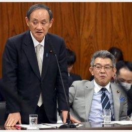 重要閣僚・総務相に武田良太氏(右)を指名した菅首相(C)日刊ゲンダイ