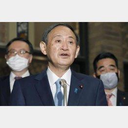 1月28日、バイデン米大統領との電話会談を終え、会見する菅首相(C)共同通信社
