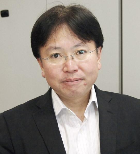 衛星・地域放送課長の井幡晃三氏(C)共同通信社